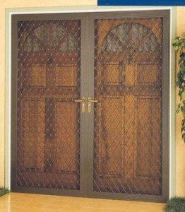French double doors with a screen door in front