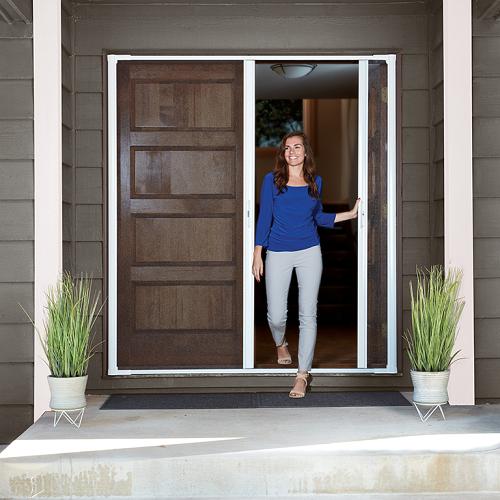 Beautiful woman opening the door of her home