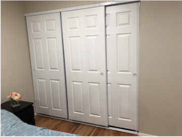 3 white sliding bedroom closet doors