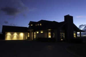 house exterior with lights on at night