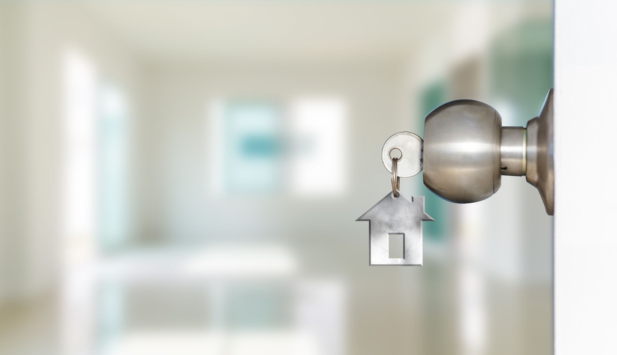 door knob with keys hanging out of them and blurry background